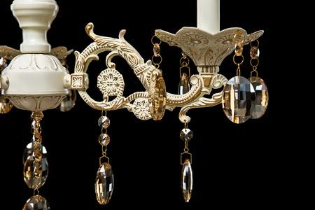 resplandor: Classic chandelier details isolated on black background. Foto de archivo