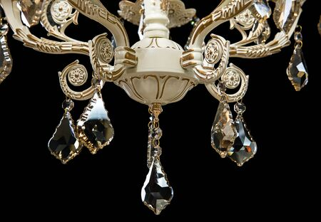 Classic chandelier details isolated on black background. Stock Photo