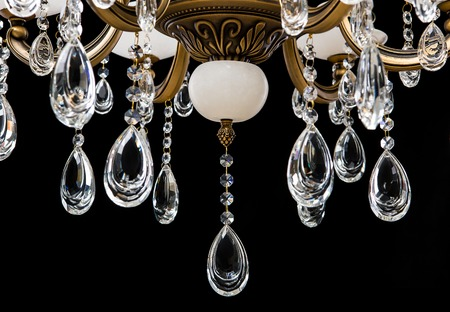 radiance: Classic chandelier details isolated on black background. Stock Photo