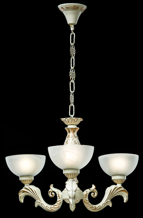 radiance: Classic chandelier isolated on black background.