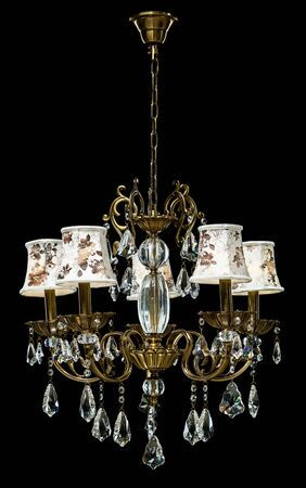 Classic chandelier isolated on black background.