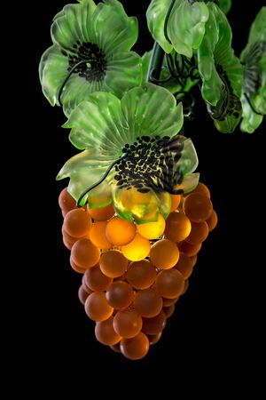chandelier background: Classic chandelier in fruit style isolated on black background.