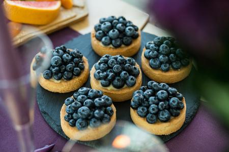 Blueberry tartlets on slate stone. Stock Photo