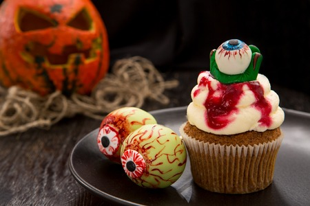 Halloween cupcake with blood monster eyes.