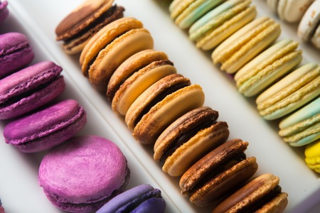 Set of different french cookies macaroons in a white box. Closeup. Coffee, chocolate, vanilla, lemon, raspberry, strawberry, pistachio, violet, rose, orange tastes macaroons Stock Photo