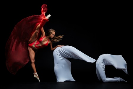 Dance show. Flexible and plastic girls. Ballet show Stock Photo
