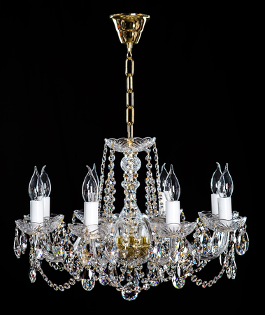 Elegant crystal strass chandelier with eight lamps.