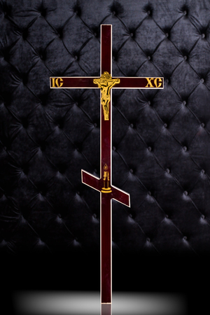 Brown wood Cross tombstone isolated on dark luxury background.