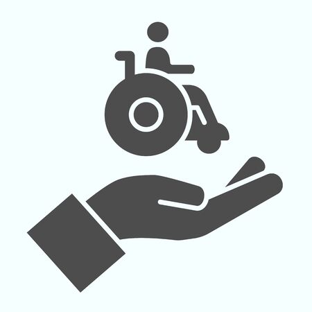 Help for people with disabilities solid icon. Disabled carriage vector illustration isolated on white. A hand holding a wheelchair with a patient glyph style design, designed for web and app.