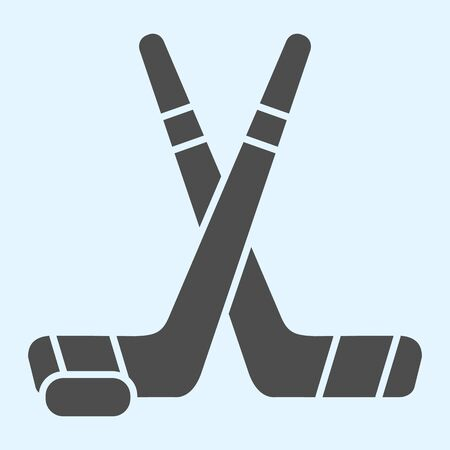 Hockey sticks solid icon. Field crossed game inventory and puck. Stock Illustratie
