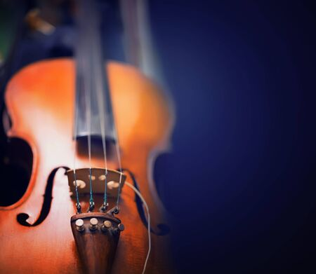 musical instruments: background with the violin toned photo Stock Photo