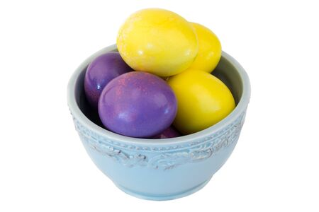 colored eggs in ceramic bowl Easter spring isolated on white background selective soft focus photo