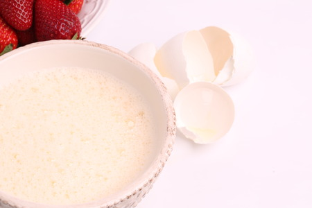 whipped to a froth the eggs in a bowl on a white background selective soft focus Stock Photo