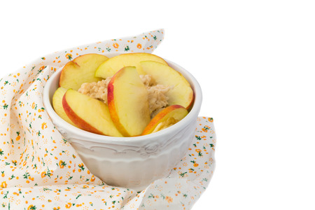 breakfast oatmeal porridge with apple in a white ceramic bowl shabby chic retro vintage health diet selective soft focus photo