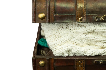 tricot: chest with knitted woolen winter clothes retro vintage Stock Photo