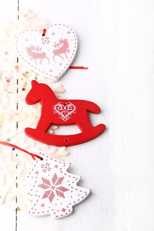 accessories horse: xmas composition Christmas card wooden toys on a white wooden background heart horse fir new year winter Stock Photo