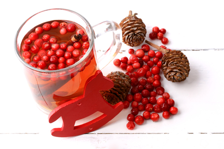 grog: Christmas tea with cranberry Christmas decorations cones grog cider winter white wooden background rustic Stock Photo