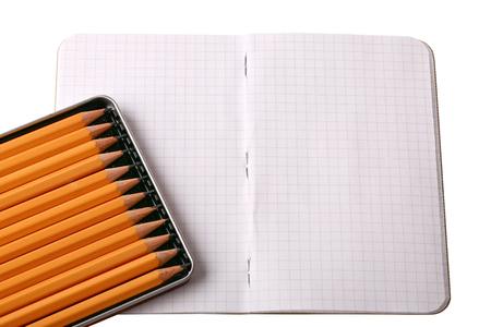 educational material: notebook set of black sketch pencils isolated on a white background