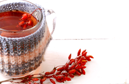 barbarum: barberry tea with a knitted mug isolated on a white background