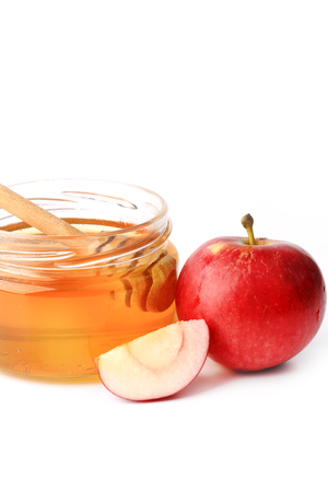 jewish group: apple with honey isolated on a white background Stock Photo