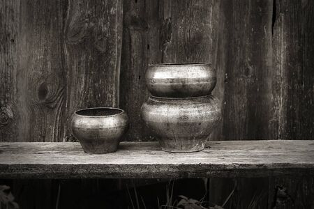 traditionally russian: antique pots for cooking in the Russian oven dark wooden background rustic style retro vintage