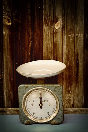 antique scales: antique scales on the old wooden background vintage retro Stock Photo