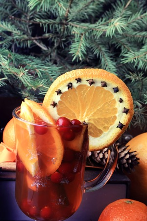 punch spice: hot punch with orange cranberry and spice vintage Christmas fir cones old wooden background rustic style Stock Photo