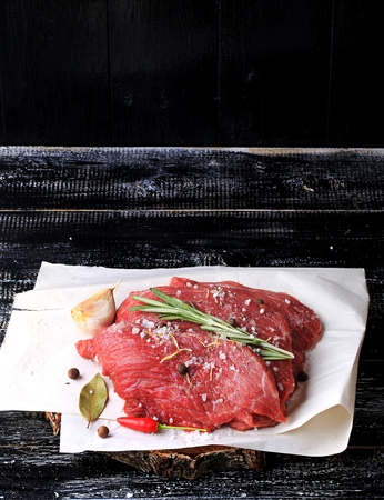 australian beef cow: piece of raw meat with spices salt pepper garlic rosemary Stock Photo