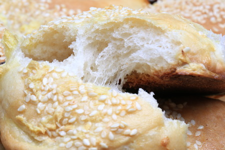 home baking: fresh bread buns with sesame garlic home baking rustic style selective focus