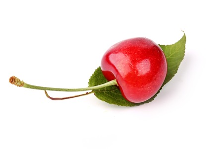 rich flavor: sweet cherries with the leaf isolated on a white background