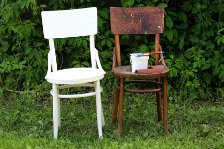 country house style: painting restoration old chair before and after Stock Photo