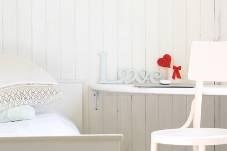 atmosphere: white romantic bedroom in a rustic wooden house workplace Stock Photo