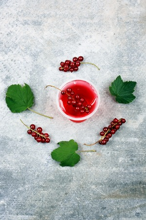 jelly head: red currant jelly on a gray stone background view from above over the head summer menu