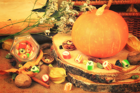 gedi: autumn background in retro style shabby chic pumpkin candy nuts