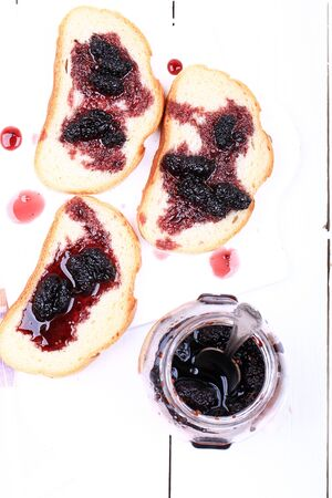 toast with jam mulberry on a white wooden background top view over head Imagens