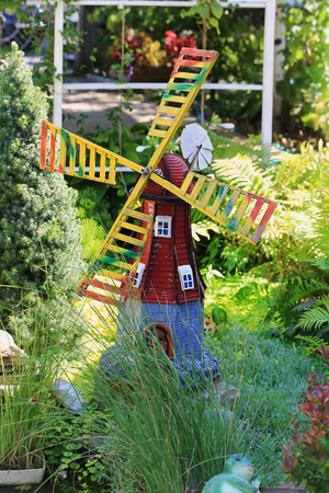 Home Garden Decor Figure Wooden Windmill In Green Grass Summer Decoration  For The Yard Stock Photo