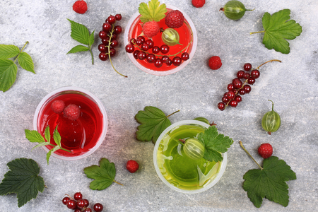 jello: jelly dessert with fresh berries pudding cream currants gooseberries raspberries Stock Photo