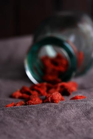 lycii: goji berries on a dark linen background selective soft focus