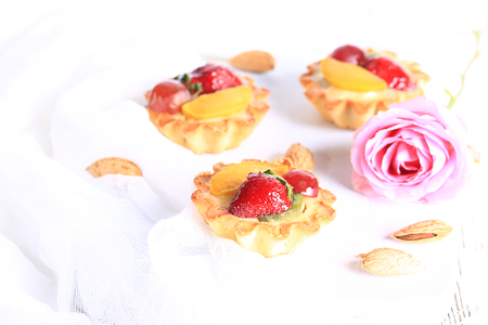 almond cake with strawberries on a white background selective soft focus