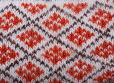 warm christmas background. knitted wool pattern