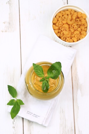 Pesto sauce for pasta on a white wooden background