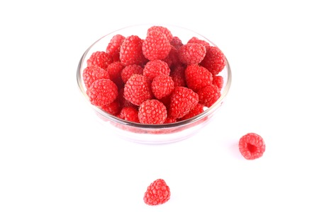 raspberry in bowl isolated on white background