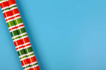 gift wrapping paper on a blue background. minimalistic christmas scandy background with empty place for text. top view, flat style