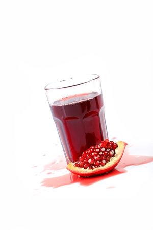 pomegranate juice on a white background