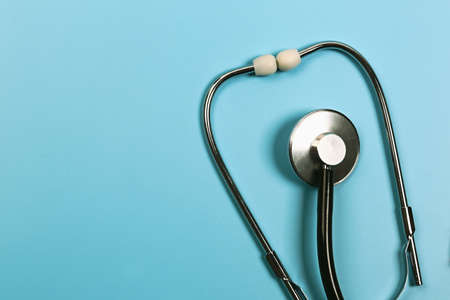 Medical concept. Stethoscope on a blue background. Flat style, top view .. Stock Photo