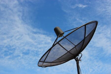 Satellite with blue sky and some clound Stock Photo - 10848950