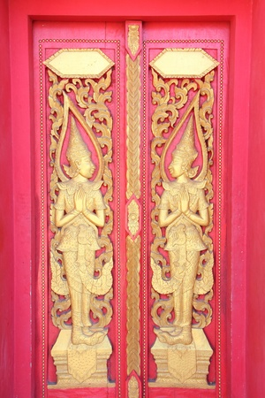 Thai style temple door in Wat Doivao at Chaingrai photo