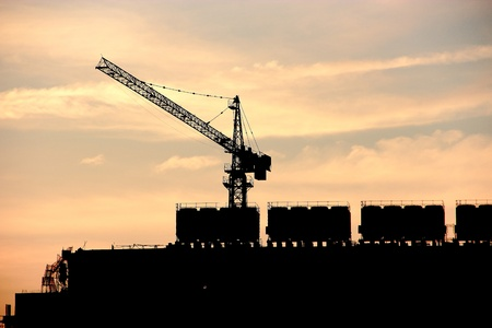 Silhouette of contruction crane at sunset