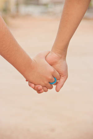 Two sister holding their hands Stock Photo - 12535709