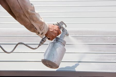 Handyman worker painting the anti-rust paint to the metal. Stock Photo - 13579862